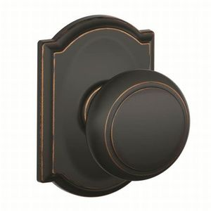 Schlage Residential F10 AND 716 CAM Andover Knob with Camelot Rose Passage Lock with 16080 Latch and 10027 Strike Aged Bronze Finish